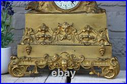 Antique french bronze gold gilt mantel clock Devil putti head couple figurines